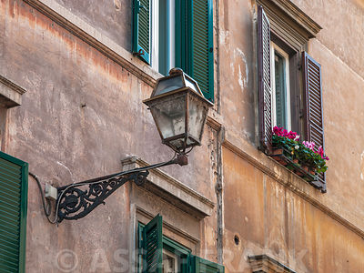 Lamp on an old buildings in city of Rome, Italy
