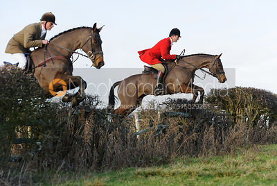 Milo Manton and Jonty Evans jumping a hedge near Hill Top Farm