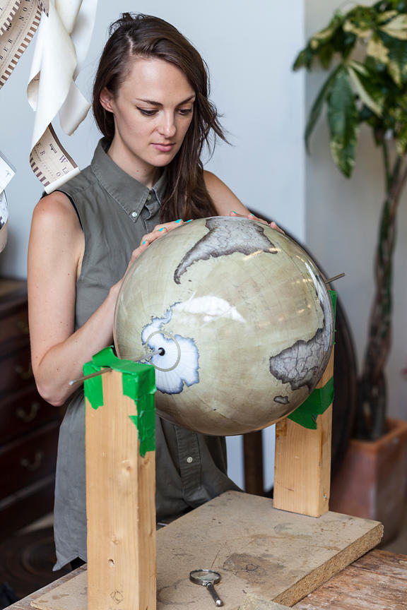 UK - London - Artists painting in the finishing touches to a gloge at Bellerby and Co. Globemakers