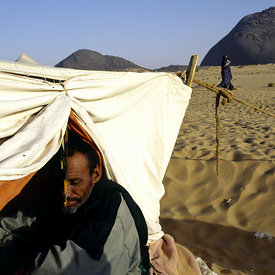 A nomad in his tent in the desert between the cities of Chinguetti and Choum. The nomads are the link between the cities and ...