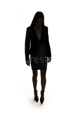 A woman, in silhouette, walking towards camera – shot from eye level.