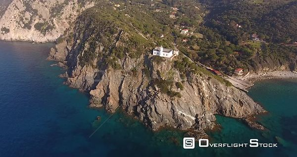 Aerial shot, beautiful lighthouse on the outcrop in Elba island in Tuscany, Italy, 4K