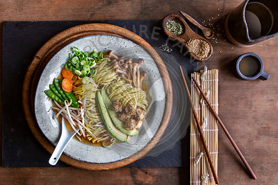 Vegan Japanese Ramen soup in grey bowl over wooden background