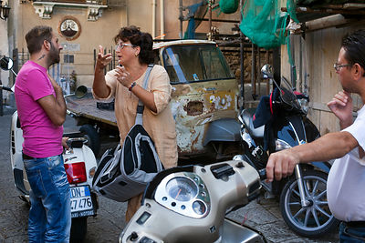Italy - Palermo - A man and a woman talk in the Capo Market