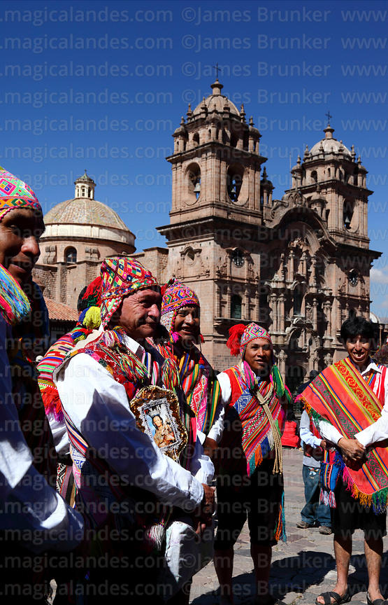 Indigenous devotees in front of Compañia de Jesus church , Corpus Christi festival , Plaza de Armas , Cusco , Peru