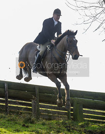 Peter Cooke jumping a hunt jump in Flitteris Park