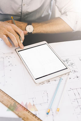 Architect working with tablet, close-up