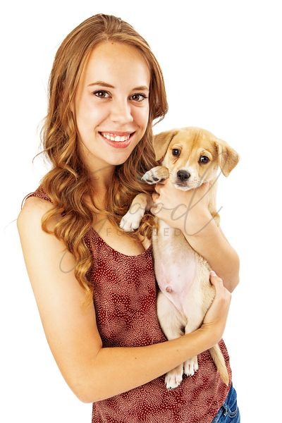 Pretty Teenage Girl Holding Puppy