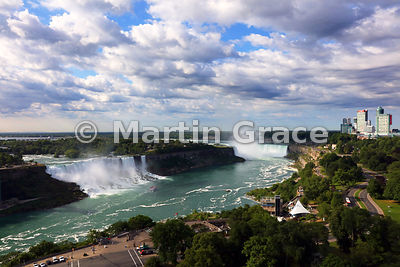 American and Bridal Veil Falls (USA - left) with Canadian Horseshoe Falls (centre right) and tourist high-rise buildings, Nia...