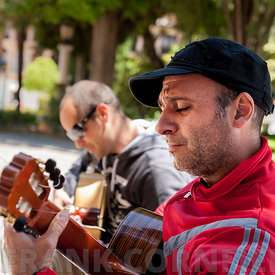 RONDA, SPAIN - MAY 21, 2012: Flamenco guitar street musicians entertaining people with flamenco music in Ronda, Andalucia, Sp...
