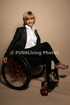 Young woman using a wheelchair in a studio shoot
