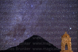 Tower of ruined church at Huacolle, Milky Way and Sajama volcano, Sajama National Park, Bolivia