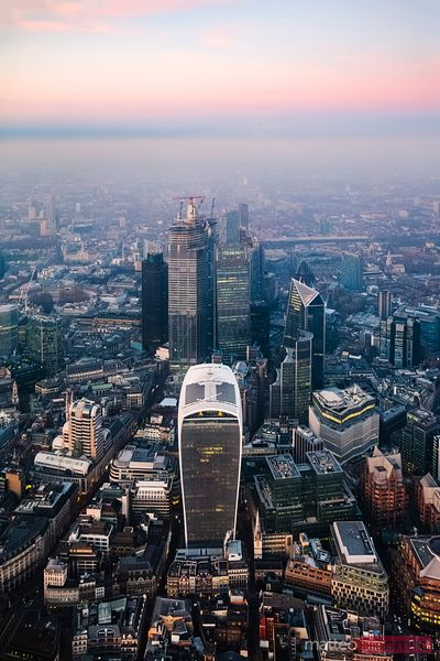 Aerial view of the City skyline at dusk, London, UK