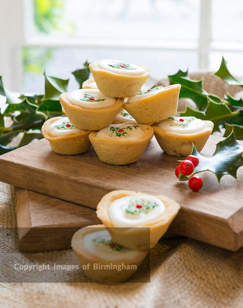 Christmas decorated mince pies in a rustic setting