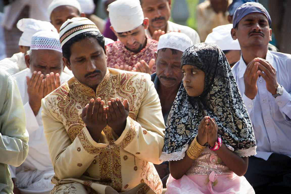 Upper class Muslim father and daughter praying during Eid al-Adha, Red Road, Madian, Kolkata, India. I have the only photos t...