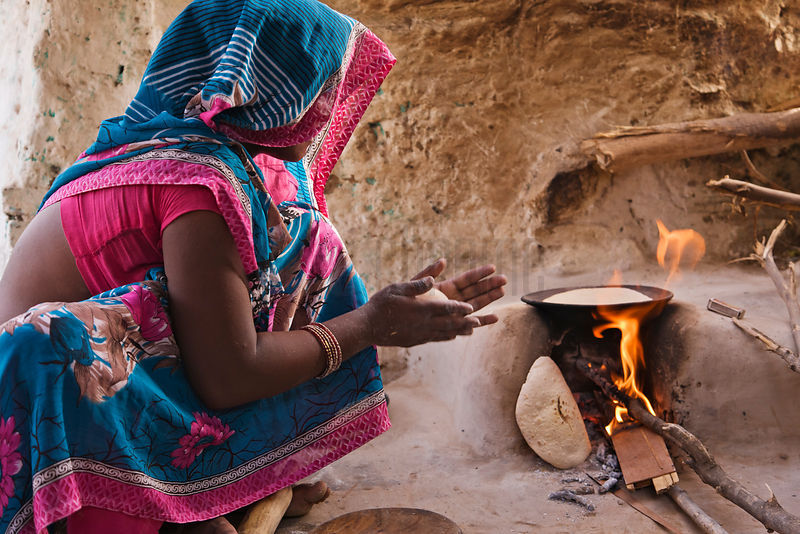 Shanty Woman Making Chapatis