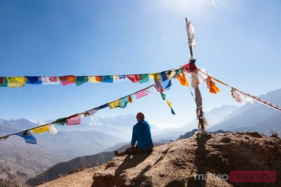 Hiker relaxing on mountain high pass, Upper Mustang, Nepal