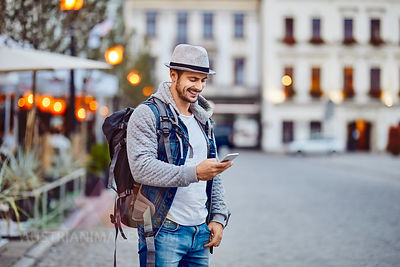 Turist using phone while on vacation in the city