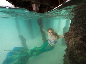 Mermaid Erin St. Blaine in murky tidal flow under bridge to Islote Yunque at north end of Isla Mujeres, Mexico.
