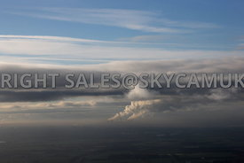 Winter Sky aerial photograph of the Steam Plumes rising from Fiddlers Ferry Power Station Cooling Towers against a background...
