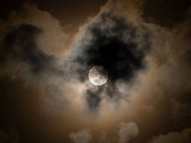 Full moon behind a cloud