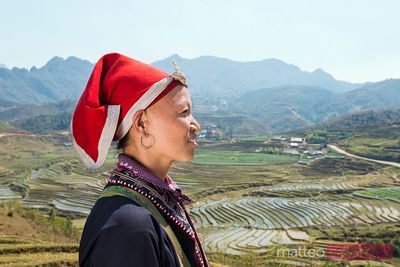 Portrait of woman from Red Dao tribe with traditional dress