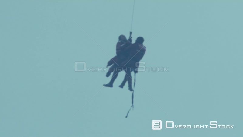 Aerial shot of two men hanging from a rescue helicopter Cape Town Western Cape South Africa