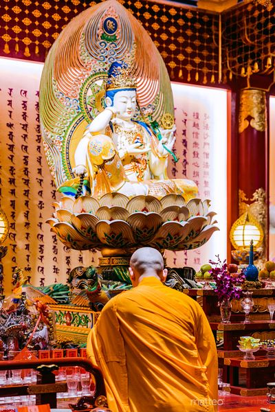 Buddhist monk at Buddha Tooth relic temple, Chinatown, Singapore