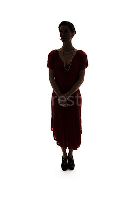 A vintage 1920s - 1930s woman in a red dress and pearls – shot from eye level.