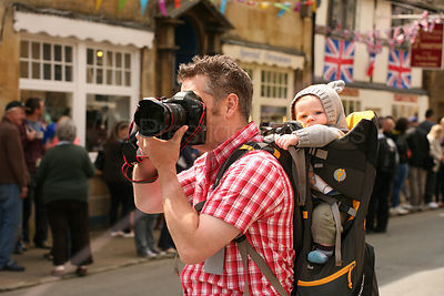 Photographer with Baby on his Back