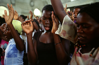 Angola - Luanda - Worshippers at prayer