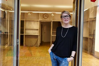 Woman standing in empty shop