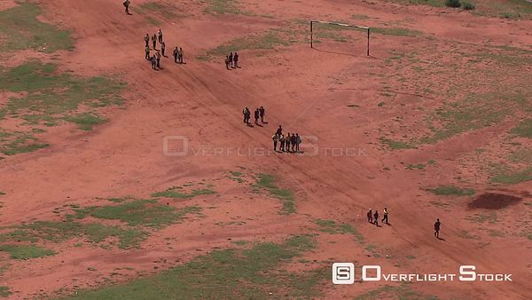 Aerial shot of people walking on a dirt road North West South Africa