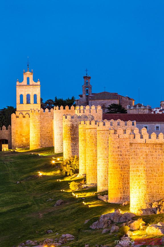 Fortified walls around the old city at night, Avila, Spain