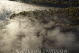 Aerial photograph of the Mississippi River with early mroning fog.