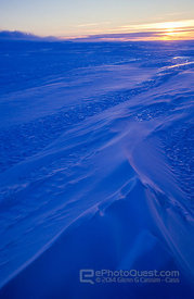 Wind-swept snow patterns on ice-plateau in twilight, MacRobertson Land, Antarctica