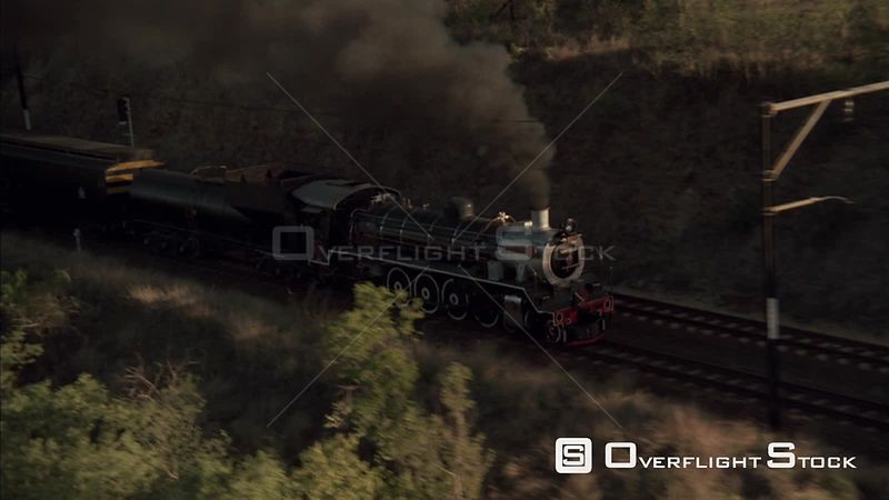 Aerial shot of steam train traveling along the tracks Johannesburg Gauteng South Africa