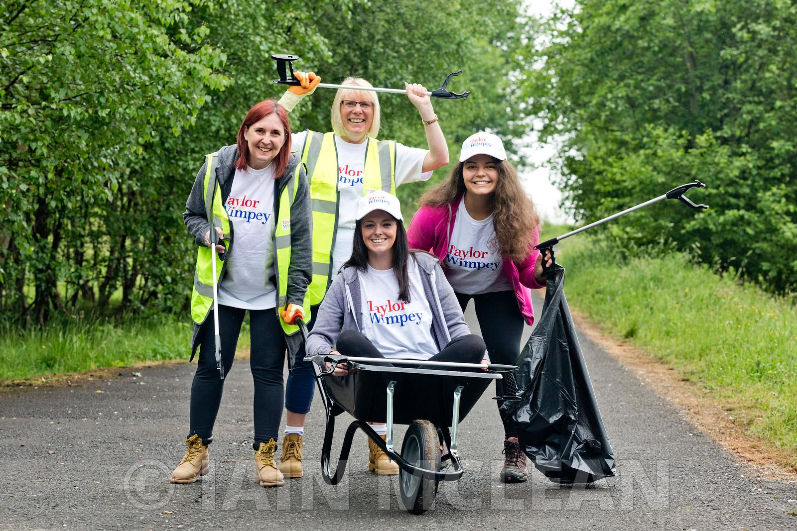 Taylor Wimpey Burnside View development, Bargeddie, Coatbridge..3.6.18..Taylor Wimpey volunteers help to clean up the area al...