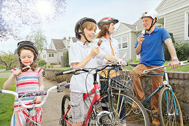 Family takes ice cream break during bike ride; Portland, Oregon, U.S.A.