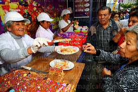 Doña Maria Luisa offering customers turrón samples during Señor de los Milagros festival, Lima, Peru