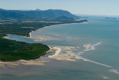 Aerial view of mudflats, mangroves and mountains near Cairns, Queensland, Australia