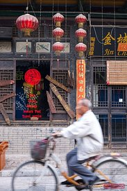 Old man riding a bicycle in the old town of Pingyao