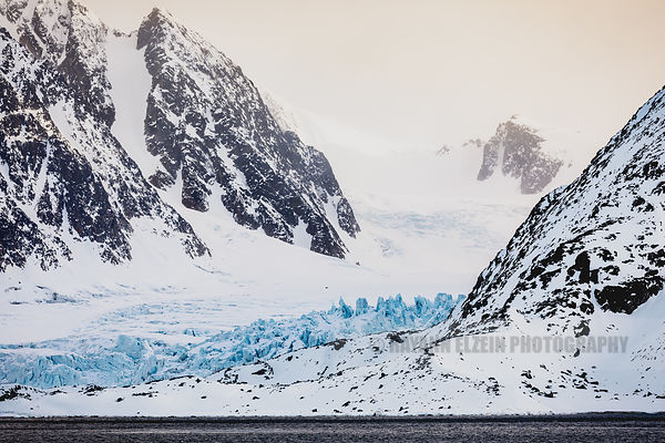 Glacier, blue ice and mountains