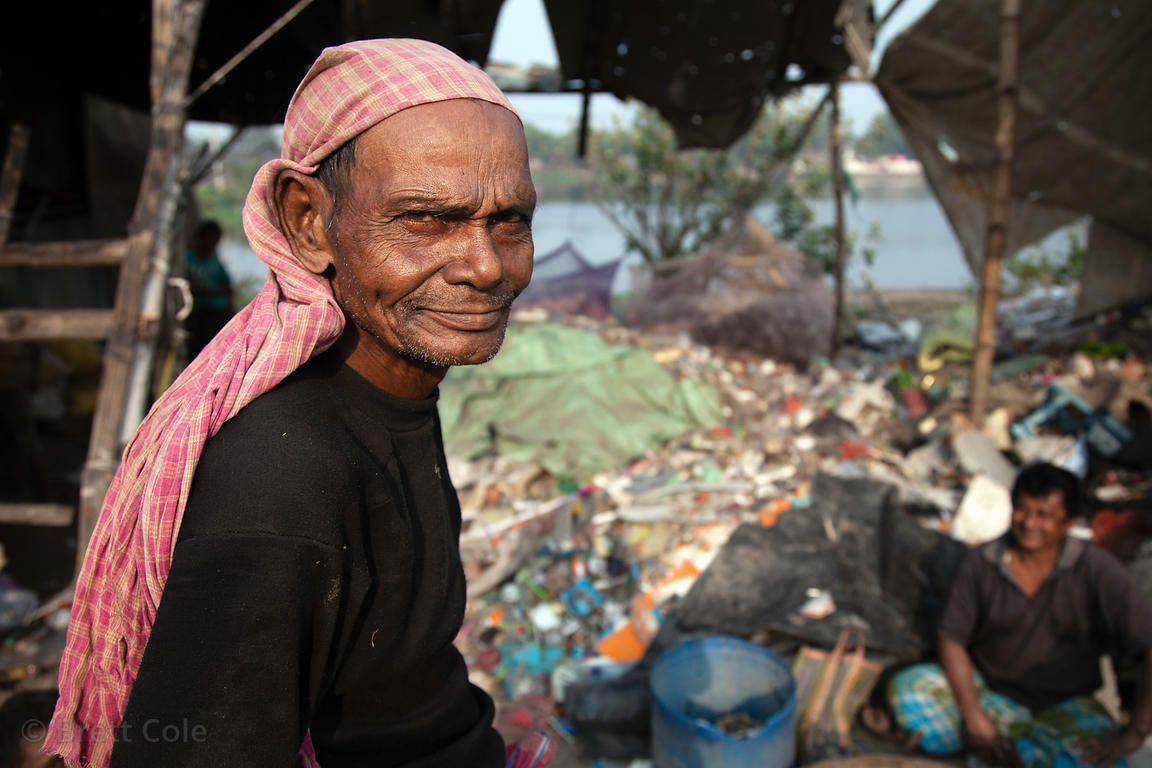 A worker at a small plastic recycling facility in Dhapa, Kolkata, India, right next to the Dhapa dumping ground, which is the...