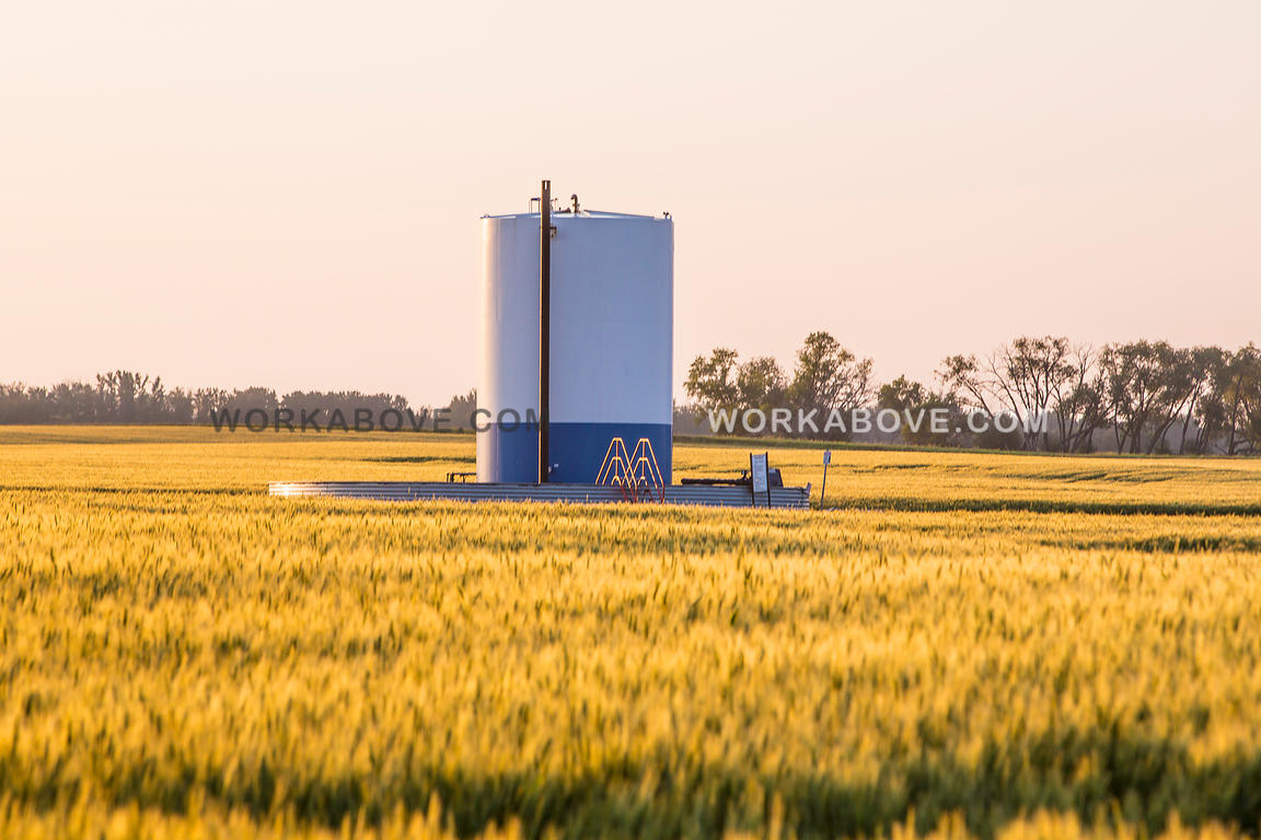 Oil tank in field