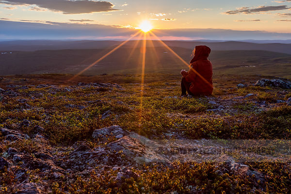 Woman enjoying the midnight sun