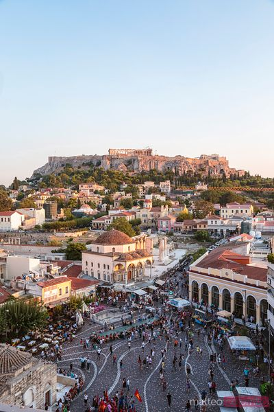 Elevated view of Monastiraki square and the Acropolis at sunset. Athens, Greece