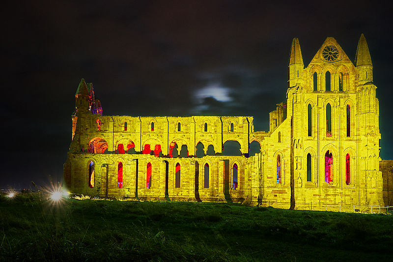 Whitby Abbey illuminated in yellow
