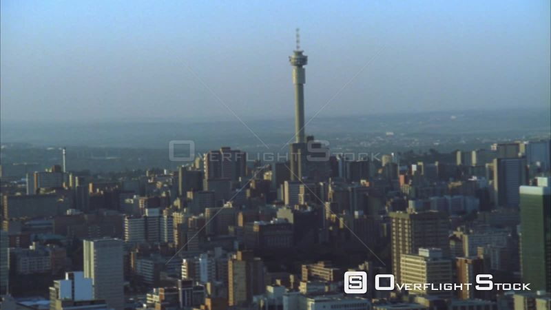 Aerial shot moving further away from the Johannesburg Central Business District at sunset/sunrise. Johannesburg Gauteng South...