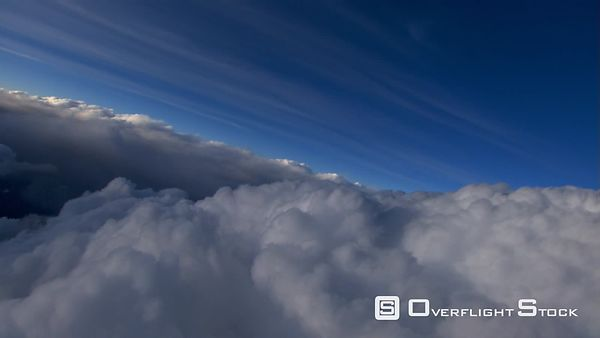 Flying over cumulus with thinner streaks above